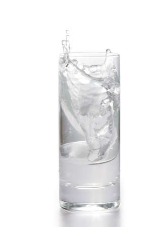Fresh water in glass with ice cubes on white