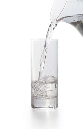 Water pouring into glass  White background Isolated with Clipping Path  Stock Photo