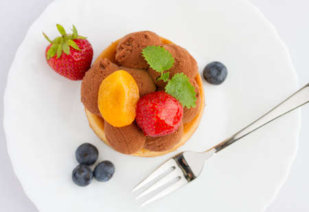 Fresh fruit tart with strawberries, blueberries and apricots, top view  photo