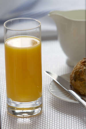 Orange juice, bread and egg for Breakfast