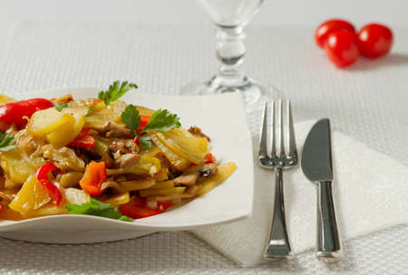 Fried potatoes with vegetables Stock Photo