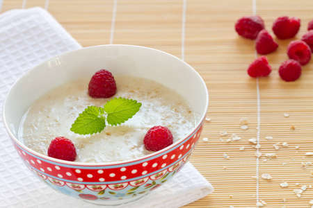 Oatmeal porridge with fresh  raspberry  Stock Photo