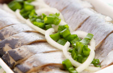 Herring fillets colose-up with herbs