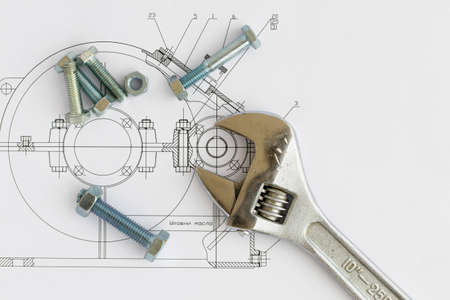 Tools on the background of technical drawings photo