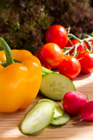 roquette: Cut vegetables, salad ingredients on wood board