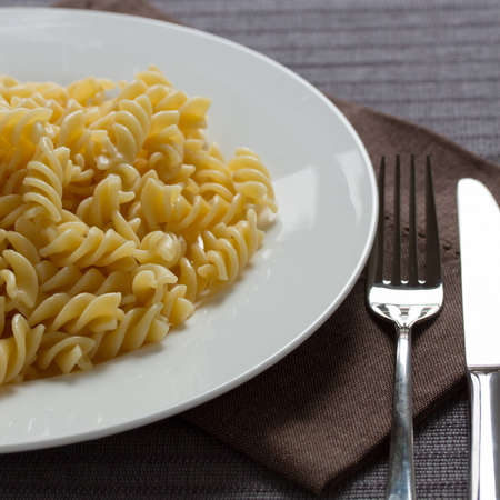 A plate with cooked pasta fusilli photo