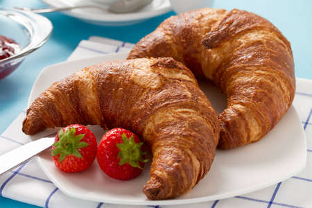 Breakfast with two croissants and berries