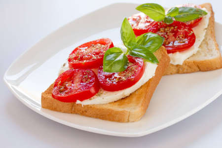 Bread with mozzarella tomatoes and basil leaves