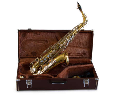 Vintage saxophone in it s original travel case isolated on white Stock Photo