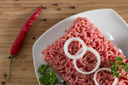 minced meat on the wooden cutting board, top view Stock Photo