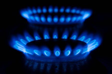 butane: Close up of a gas burner flame on black background