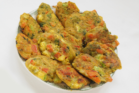 Healthy baked vegan vegetable pakoras Stock Photo