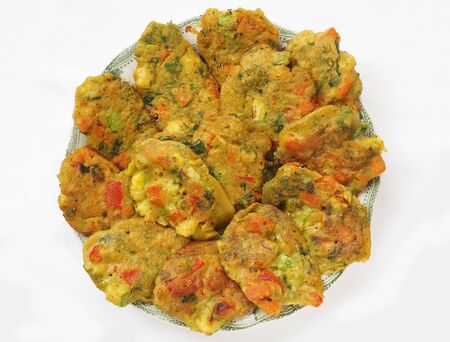 veda: Healthy baked vegan pakoras, top view. Stock Photo
