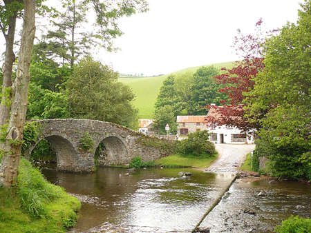 calming: Pack Horse bridge over Badgworthy Water, Exmoor, South West England Stock Photo
