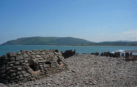 Wartime bunker and remains of sea defences on the beach, South West England Stock Photo