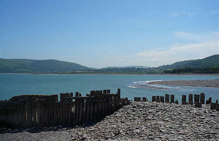 Remains of old sea defences on a beach, South West England