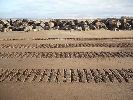 going nowhere: Parallel lines in the sand made by machinery tracks, South West England Stock Photo