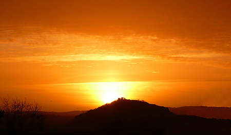 Sunrise over Conygar Tower, Dunster, South West England