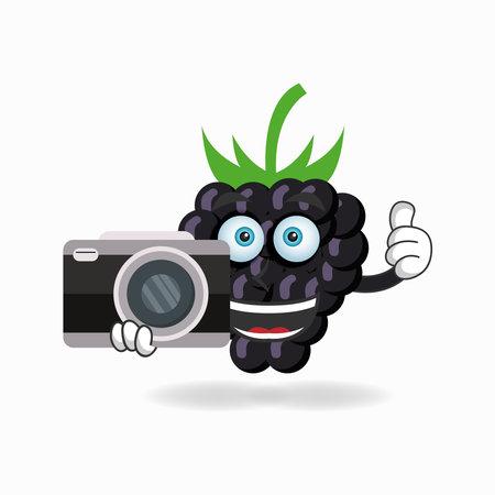 Grape mascot character holding camera. vector illustration