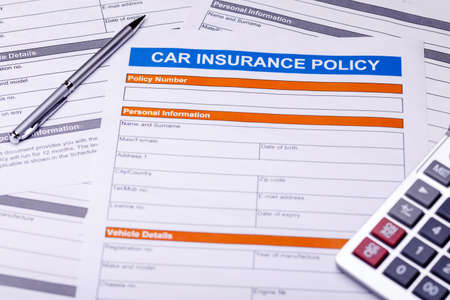 Car insurance policy. Documents, pen and calulator on table. Business and insurance background concept.