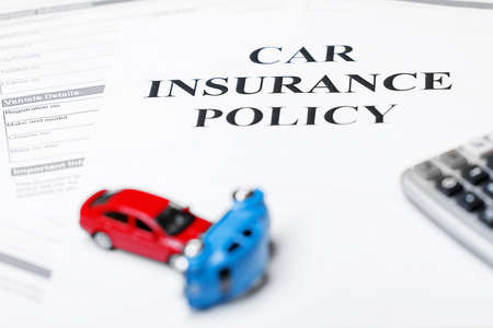Car models with calculator on car insurance policy. Business and insurance concept