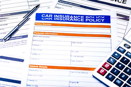 Car insurance policy. Document, pen, calculator on table. Business and insurance background concept.