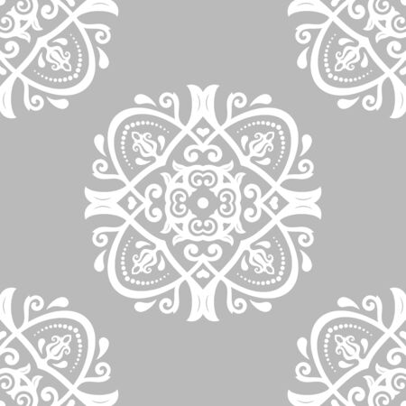 Classic seamless pattern. Damask orient gray and white ornament. Classic vintage background. Orient ornament for fabric, wallpaper and packaging 스톡 콘텐츠