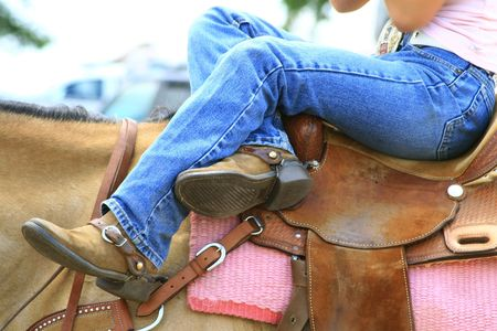 rider reclining on her horse