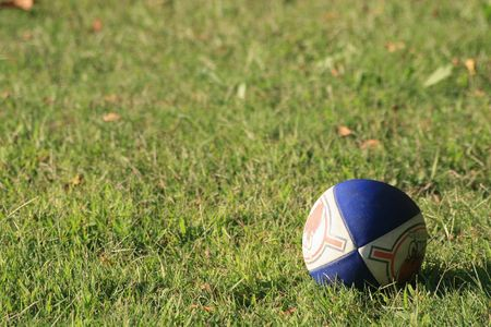 Rugby ball lying on the field