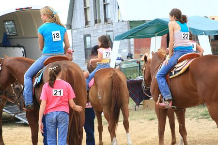 Female competitors and horses