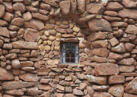 stonemasonry: Rock building with a stain glass window