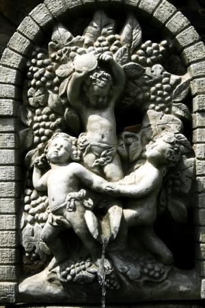 Cherub wall fountain