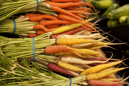 Bunches of colorful carrots from farm to table