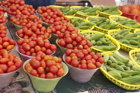 Baskets of mini tomatoes and okra