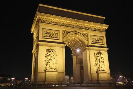 A night time view of the Arc de Triomphe Paris, France photo