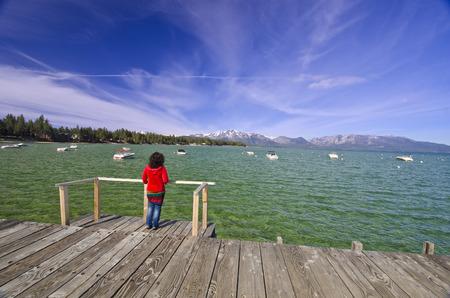 sand harbor: A woman watching beautiful lake tahoe