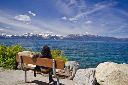 beautiful lake: A woman watching beautiful lake tahoe