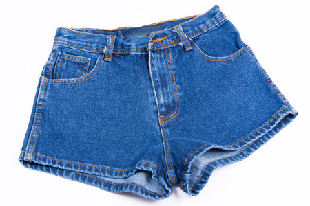 jeanswear: Blue jean shorts with a white background