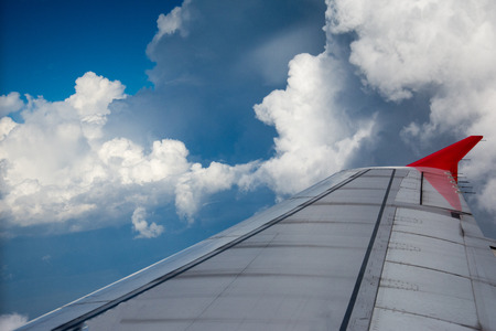 looking through window: Looking through window aircraft during flight in wing with a nice blue sky. Stock Photo