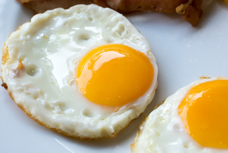 breakfast eggs: fried eggs on a white plate