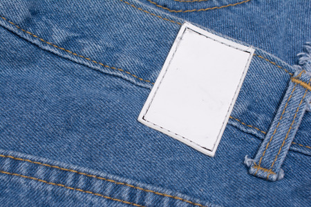 inner wear: Back of blue jeans with leather label