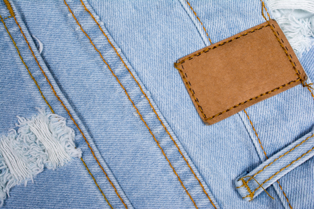 leather label: Back of blue jeans with leather label