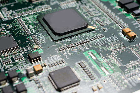 Detail of an electronic printed circuit board with many electrical components Stock Photo