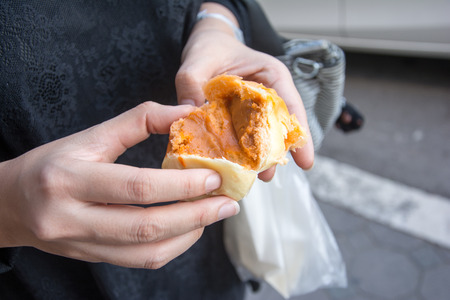 Steamed dumpling or chinese bun thai tea on the hand going to eat
