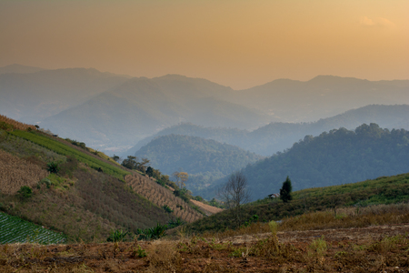 Landscape and nature sunrise on natural mountain on morning, thailand Stock Photo