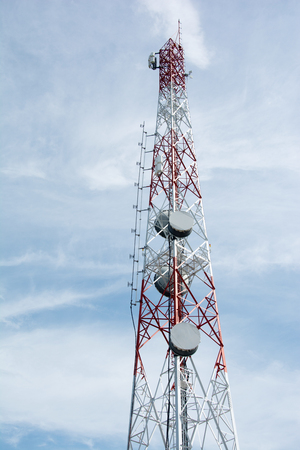Telecom and television antennas satellite dish communication tower pole with blue sky and cloud