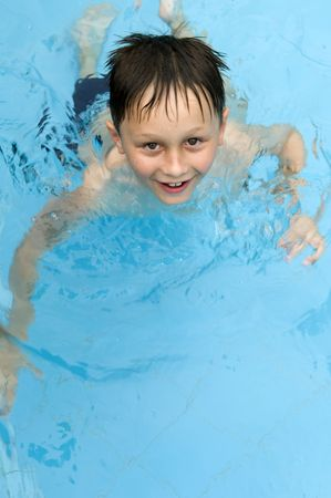 Boy swimming photo