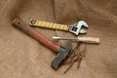 old tools: Old tools on a background of burlap. Stock Photo