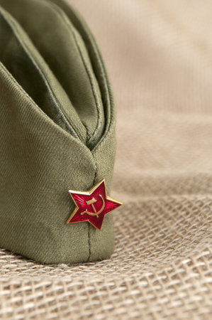 Army cap with a star on the background fabric.