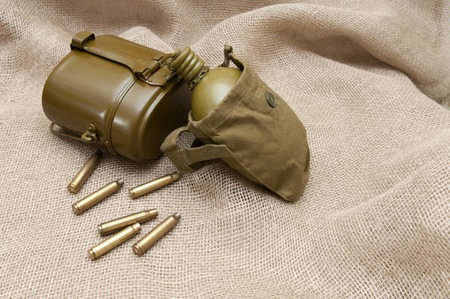 rudely: Army water bottle and cartridges on the background fabric.